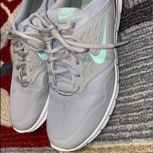 Cute gray and blue Nike shoes size 9.5 women